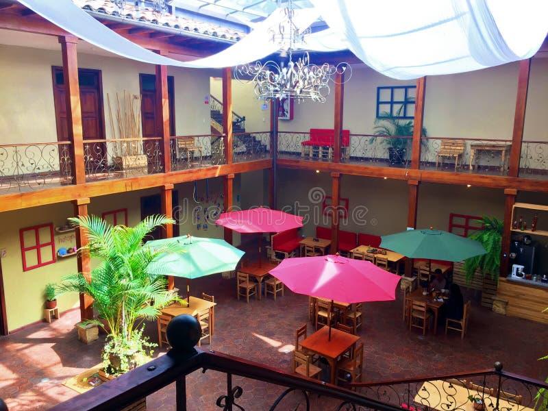 CUENCA BED & BREAKFAST, ATRIUM. Colorful and vibrant open atrium at Pepe`s Hostel in historic downtown Cuenca, Ecuador stock image