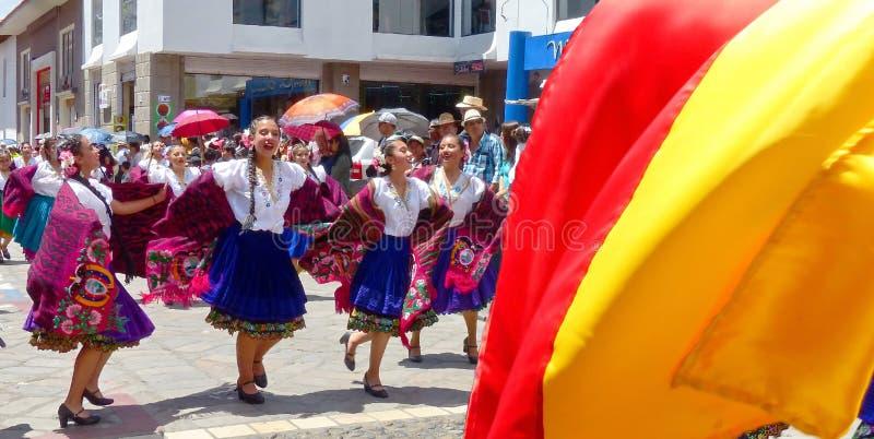 Folk dancers and flag of Azuay province, Ecuador stock photos