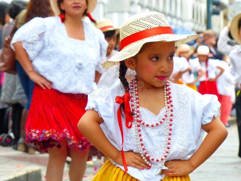 Cuenca, Ecuador. Little girl dancer dressed in colorful costumes as cuencana royalty free stock photos