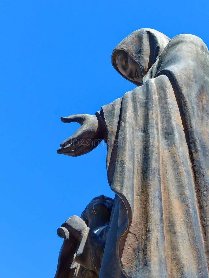 The statue of Saint Anna - Patronуess of Cuenca, Ecuador. Cuenca, Ecuador - May 11, 2019: Bronze sculpture of Saint Anne - Patronуess of Cuenca, Mother of royalty free stock photos