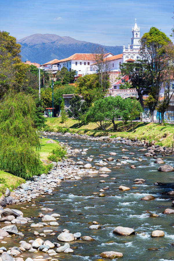 Cuenca, Ecuador River View. View of a church in Cuenca, Ecuador with the Tomebamba River in the foreground royalty free stock photo