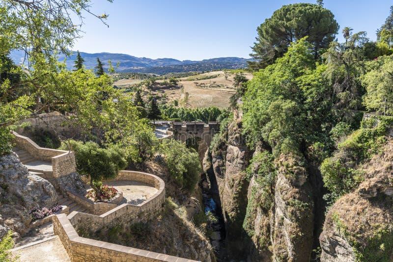 Cuenca Gardens and Puente De San Miguel Bridge Ronda Spain. Cuenca Gardens and Puente De San Miguel Bridge in Ronda. Andalusia, Spain, Europe stock image
