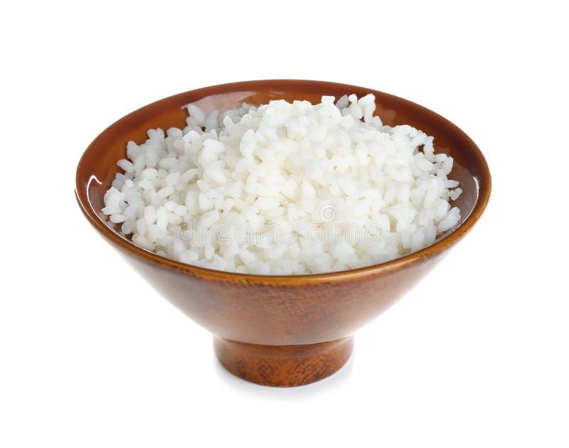Cuenco con arroz recientemente cocinado en el fondo blanco fotografía de archivo