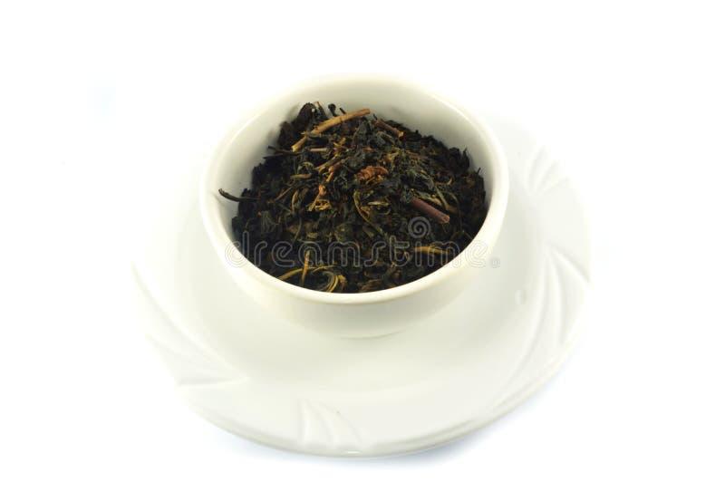 Cuenco con té seco foto de archivo libre de regalías