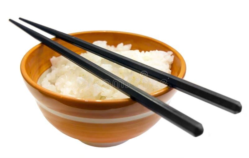 Cuenco de arroz y palillos japoneses imagen de archivo libre de regalías