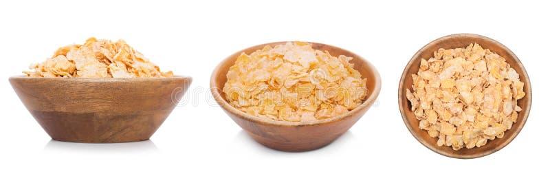 Cuenco de madera de bambú con el cereal orgánico del granola imagen de archivo
