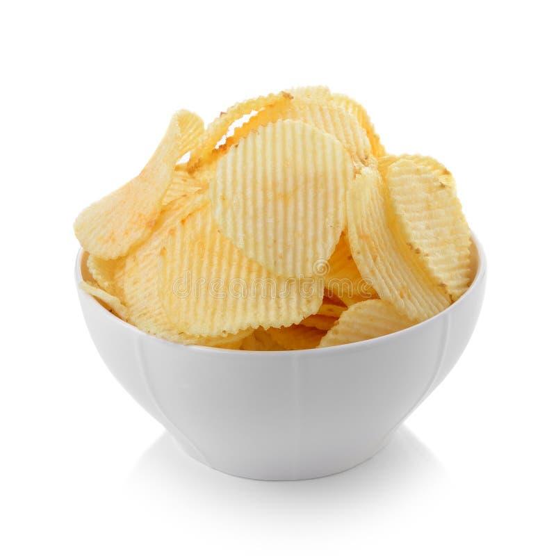 Cuenco de patatas fritas en el fondo blanco fotos de archivo libres de regalías