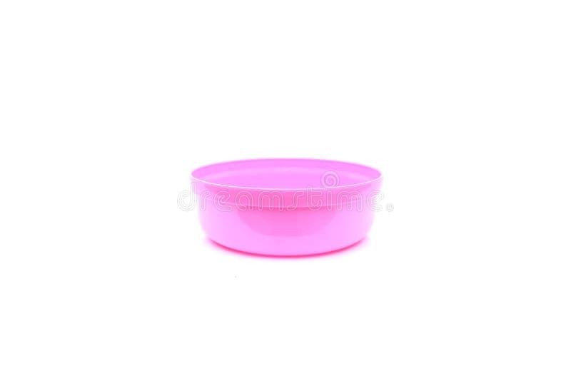 Cuenco plástico rosado en aislado foto de archivo