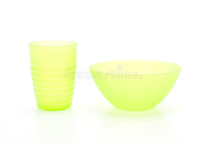 cuenco y vidrio plásticos verdes imagenes de archivo