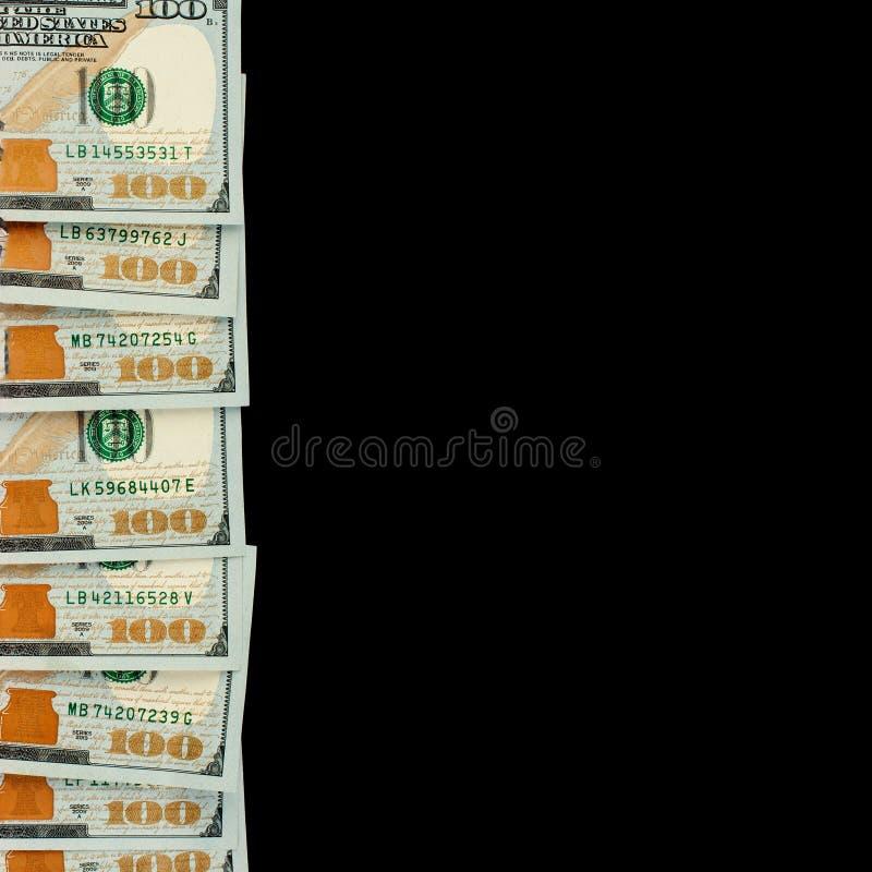 Cuenta de la frontera del dólar americano en fondo negro Billete de banco americano de los dólares 100 del efectivo del dinero fotos de archivo libres de regalías