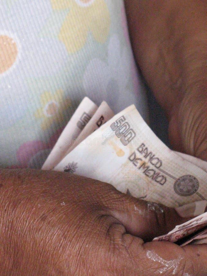 Cuenta de Pesos mexicanos en una institución del microfinance imagen de archivo