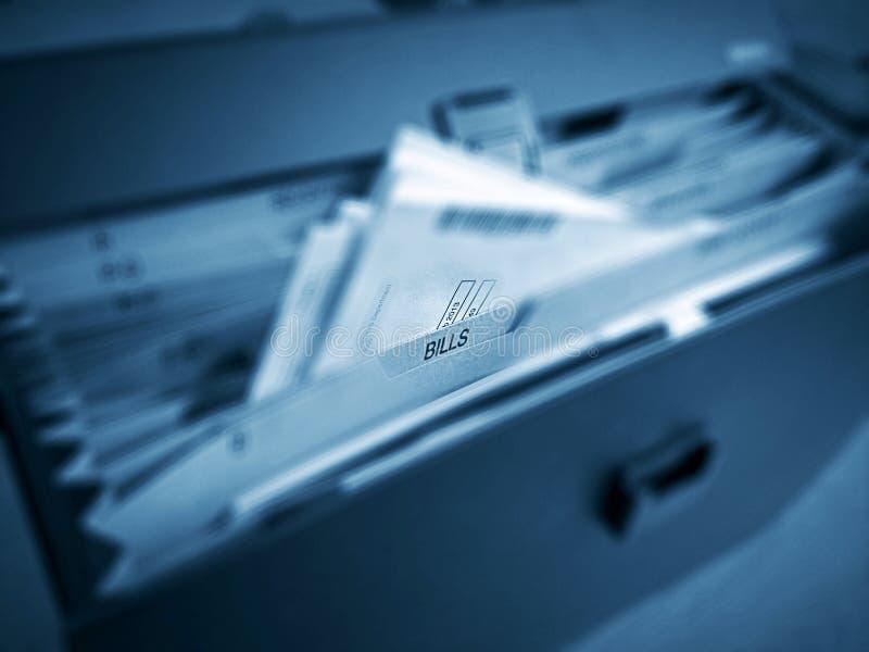 Cuentas y carpeta de la deuda imágenes de archivo libres de regalías