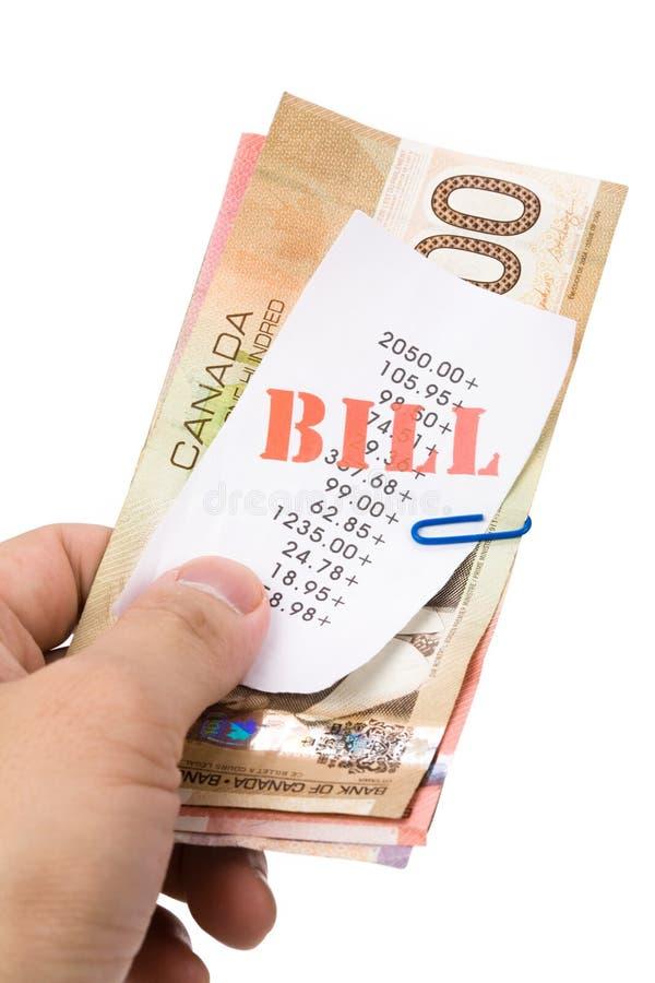 Cuentas y dólares canadienses fotografía de archivo libre de regalías