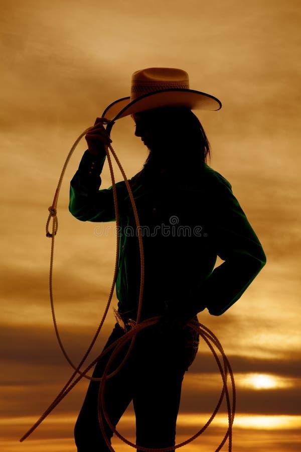 Cuerda de la vaquera de la silueta de la mujer fotos de archivo