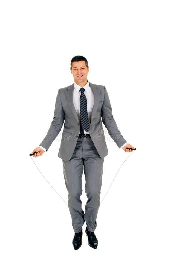 Cuerda de salto del hombre de negocios imagen de archivo libre de regalías