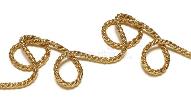cuerda dorada sobre blanco imágenes de archivo libres de regalías