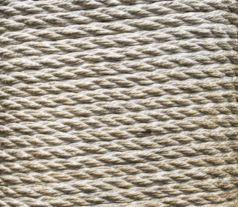 Cuerda gruesa de Ecru envuelta alrededor de un pilar fotografía de archivo libre de regalías