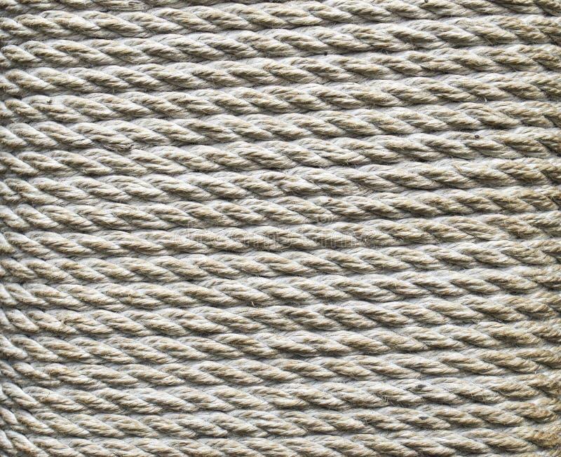 Cuerda gruesa de Ecru envuelta alrededor de un pilar fotografía de archivo