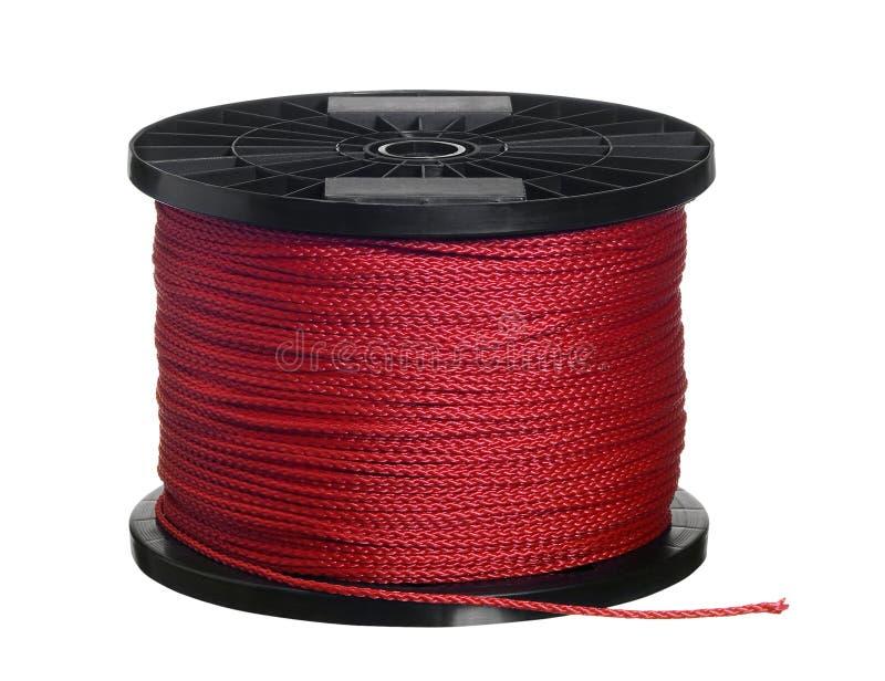 Cuerda roja en bobina negra foto de archivo