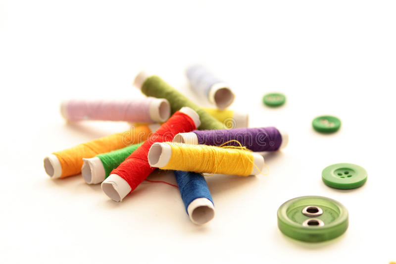 Cuerdas de rosca y botones fotografía de archivo