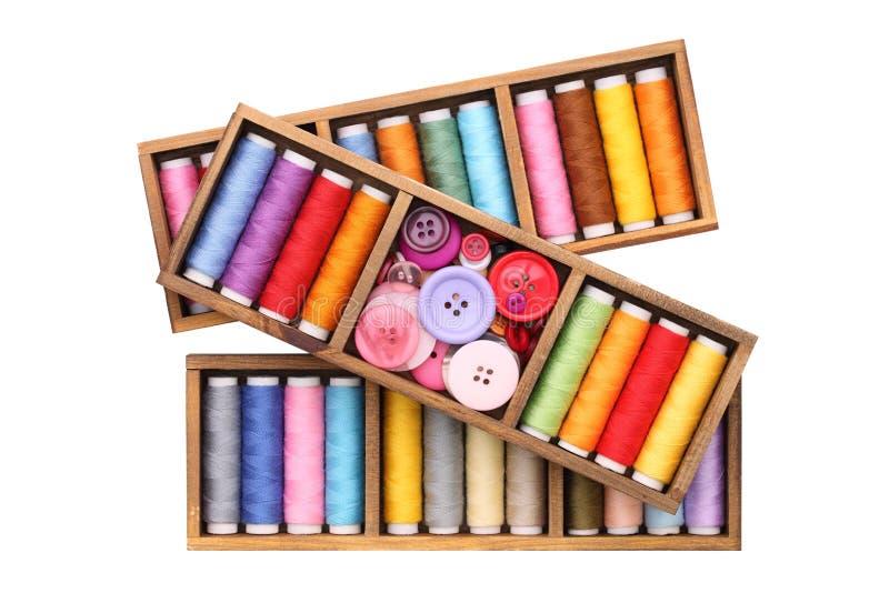Cuerdas de rosca y botones imagen de archivo libre de regalías