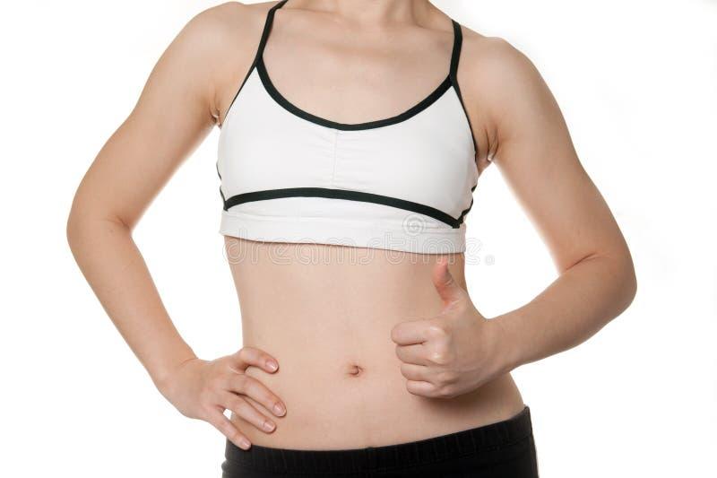 Cuerpo sano de la mujer del ajuste en desgaste de los deportes imagen de archivo