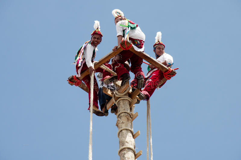 CUETZALAN, MEXICO - 2012: A family of acrobats known as `los voladores` perform in the Cuetzalan zocalo royalty free stock photos