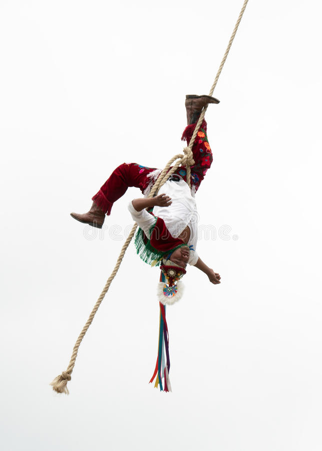 CUETZALAN, MEXICO - 2012: A member of the acrobats known as `los voladores` performs in the Cuetzalan zocalo royalty free stock images