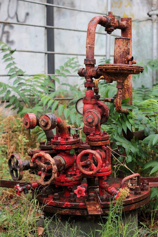Cueza el diseño al vapor rojo punky el engranaje del mecanismo del hierro fotos de archivo