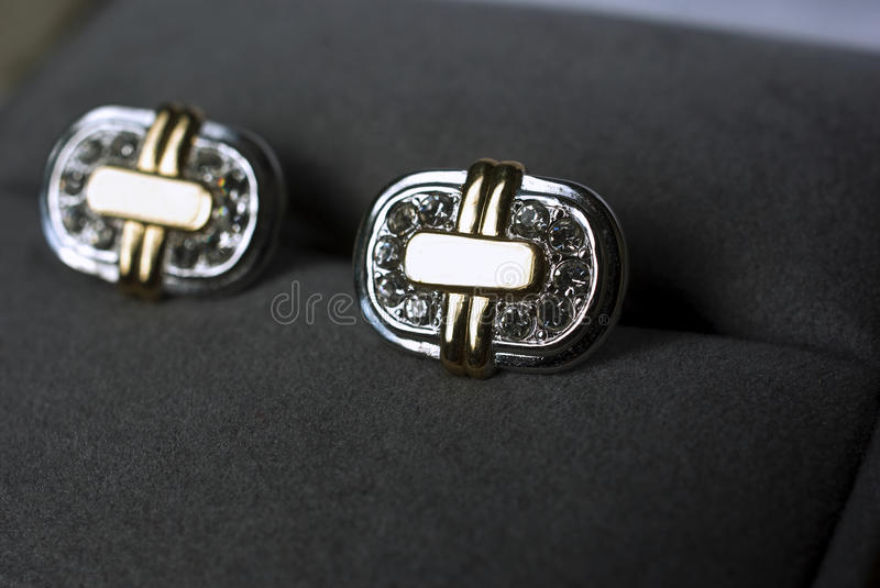 Cuff links in a box stock photos