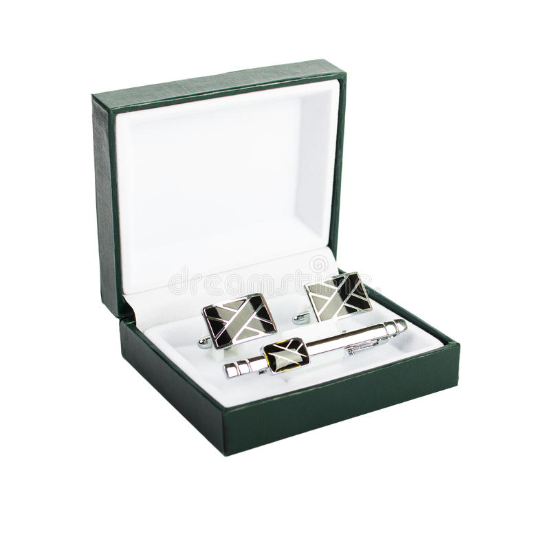 Cuff links in a box on white background. Male fashion accessories royalty free stock photo