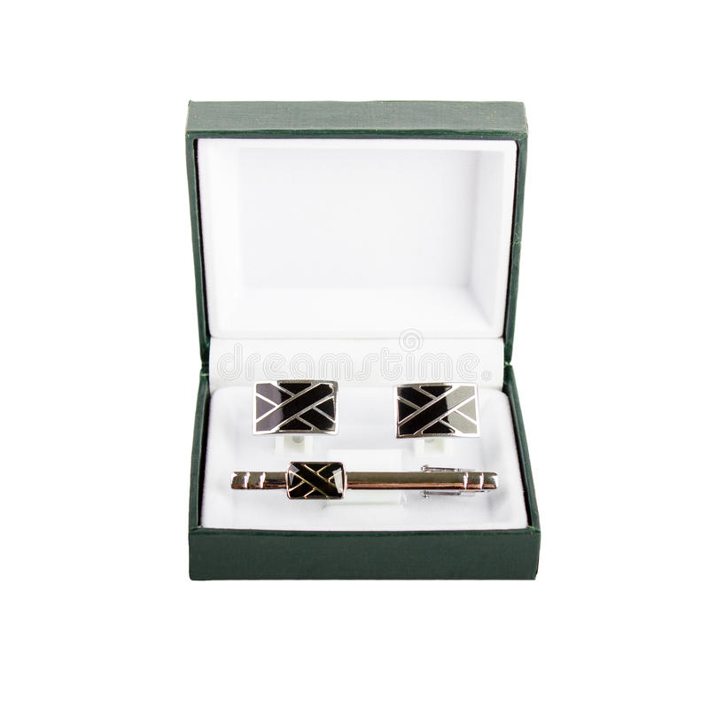 Cuff links in a box on white background. Male fashion accessories royalty free stock photography