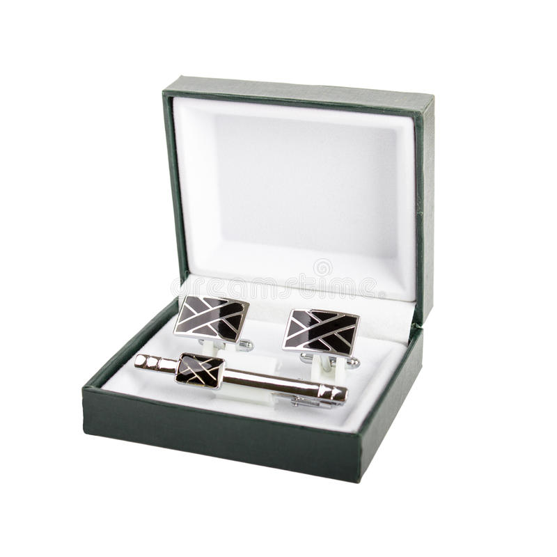 Cuff links in a box on white background. Male fashion accessories stock photos