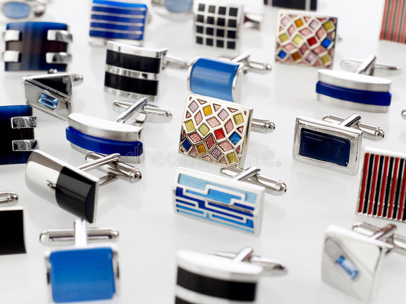 Cuff links. Various cuff links on white stock photos