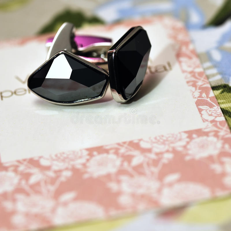 Cuff-links on wedding card royalty free stock images