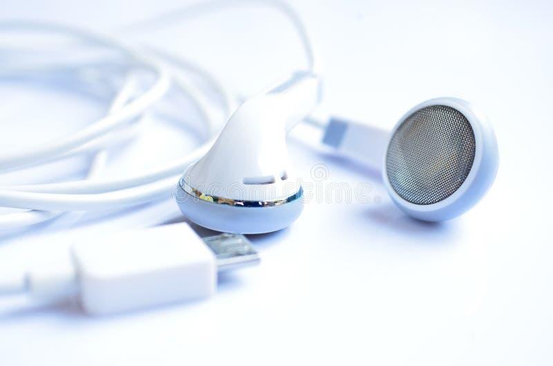 Download Cuffie bianche immagine stock. Immagine di earplug, audio - 30829281