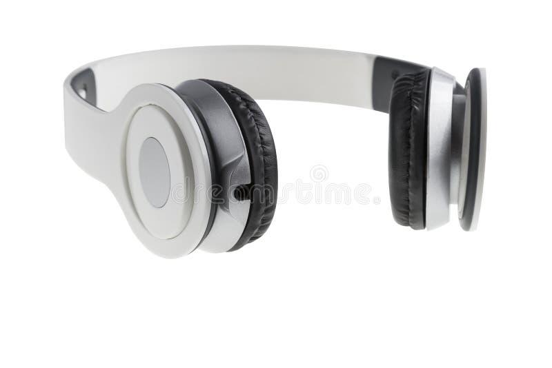 Cuffie bianche con riempimento nero fotografia stock libera da diritti