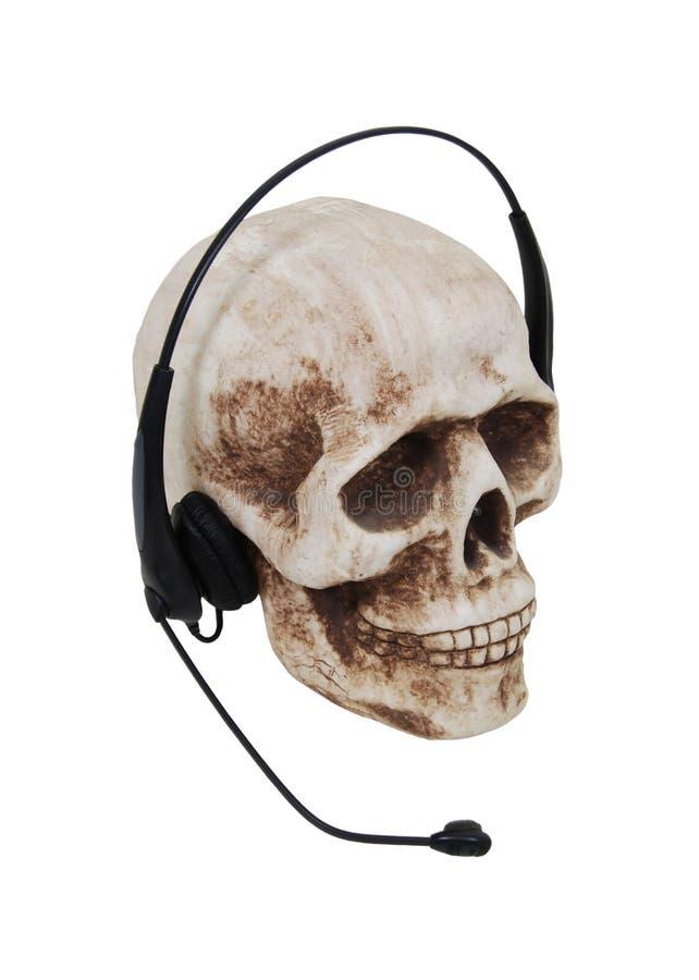 Cuffie su un cranio immagine stock libera da diritti