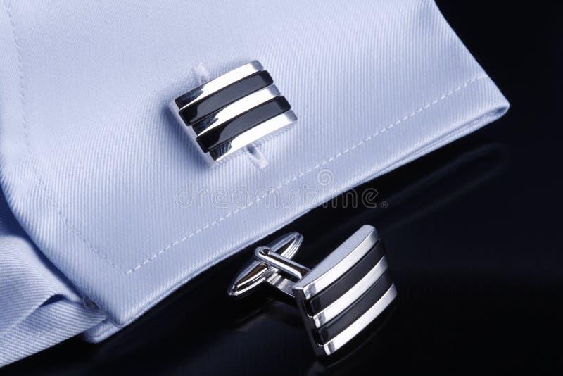 Cufflinks on blue shirt royalty free stock photo
