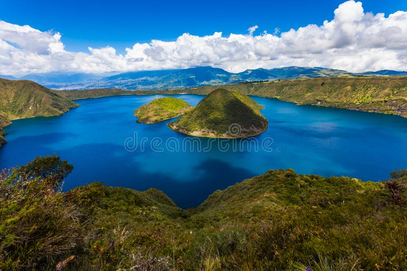 Cuicocha lagoon inside the crater of the volcano Cotacachi. Cuicocha, beautiful blue lagoon inside the crater of the Cotacachi volcano royalty free stock image