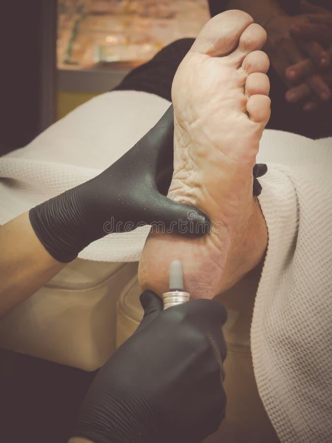 Cuidado de pie cosmético Tratamiento del talón del pie fotografía de archivo