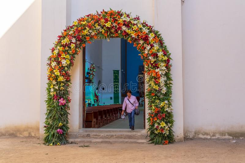 Flowering door of Cuilapam church, Mexico. Cuilapam covent, in Oaxaca area, was built in 1555 by Dominican priests to evangelize Indians in the area royalty free stock image