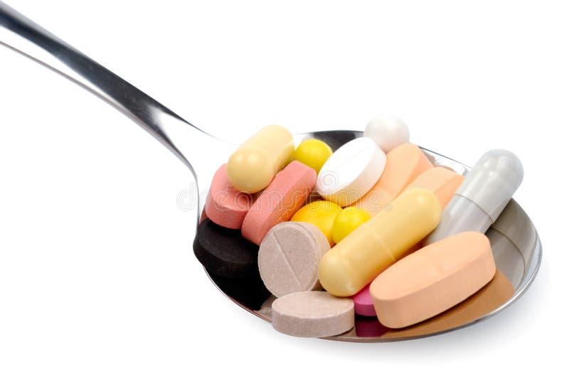 Cuillère des drogues de comprimés de vitamines de pillules photo stock