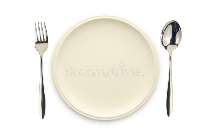 Cuillère et fourchette blanches vides de paraboloïde photos stock