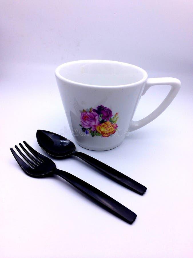 Cuillère et fourchette de tasse photo stock