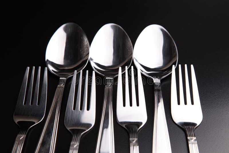Cuillères et fourchettes images stock