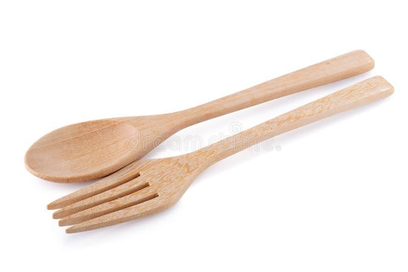 Cuill?re en bois et fourchette en bois d'isolement sur le fond blanc photos libres de droits