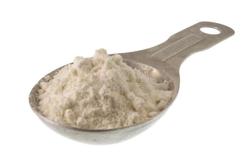 Cuiller à soupe de farine de blé blanche ou de toute autre poudre image stock