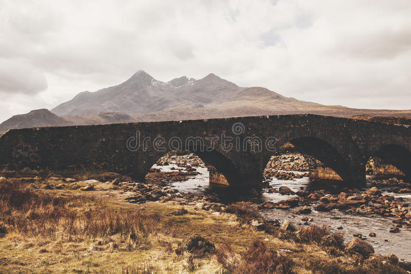 Cuillin bridge and mountains on Isle of Skye, Scotland stock images