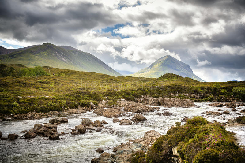 The Cuillin Hills and fast moving river stock images